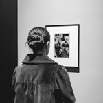 Woman looking at a Diane Arbus photo